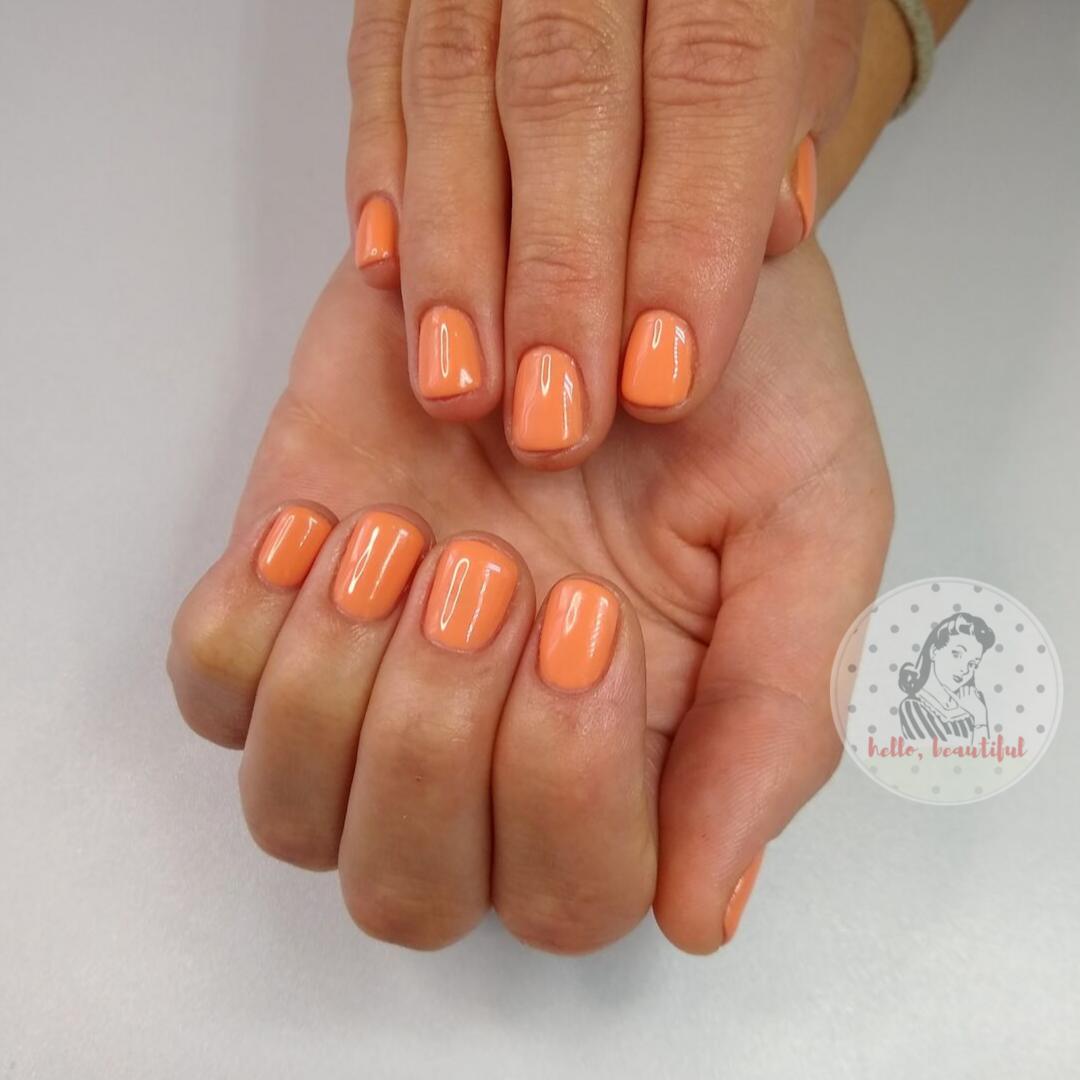 orange plain manicure