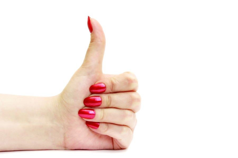 Female hand with thumb up